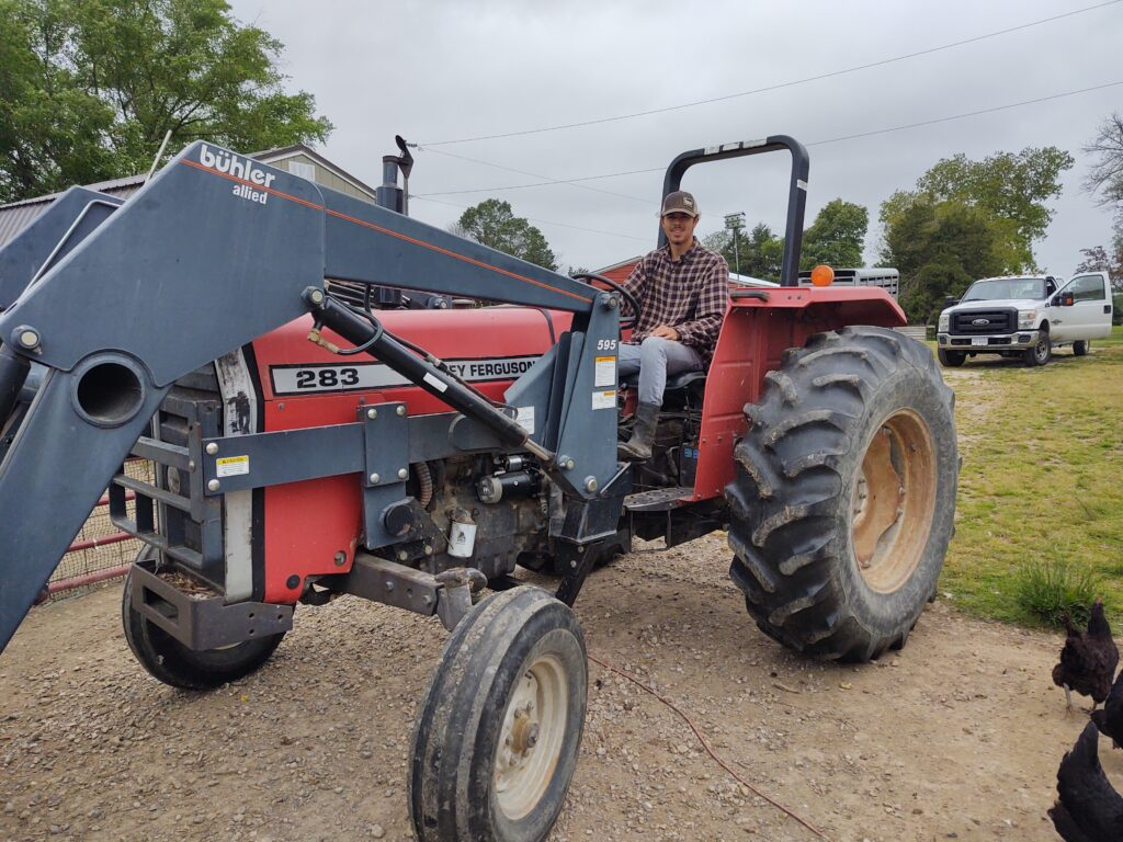 Christian on tractor
